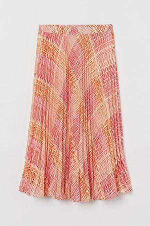 H&M Jupe plissée en mousseline
