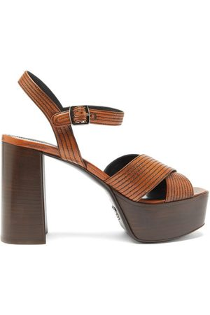 Prada Femme Sandales - Sandales en cuir à plateforme et surpiqûres