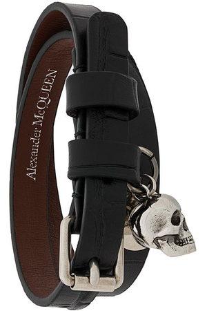 Alexander McQueen Bracelet multi-tour à breloque tête de mort