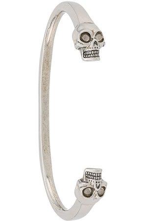 Alexander McQueen Bracelet torque à têtes de mort