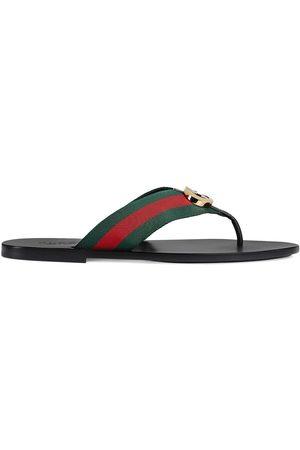 Gucci Sandales rayées à plaque logo