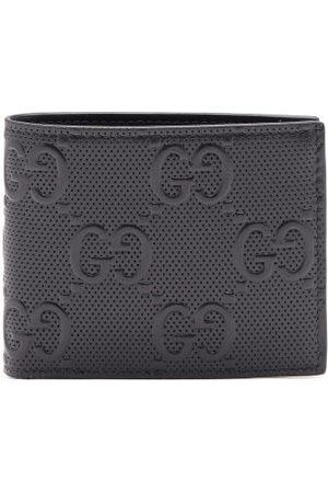 Gucci Portefeuille en cuir à deux volets et logo embossé