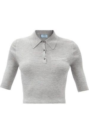 Prada Polo en laine mélangée côtelée à jacquard logo