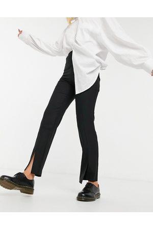 ASOS Pantalon slim ample fendu sur le devant