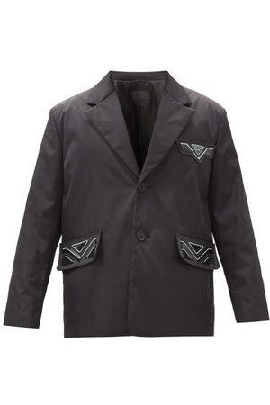 Prada Manteau en nylon à empiècement logo caoutchouc