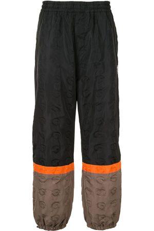 UNDERCOVER Pantalon de jogging colour block
