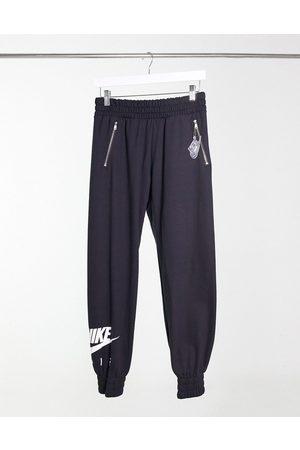 Nike Air - Jogger avec poche à fermeture éclair