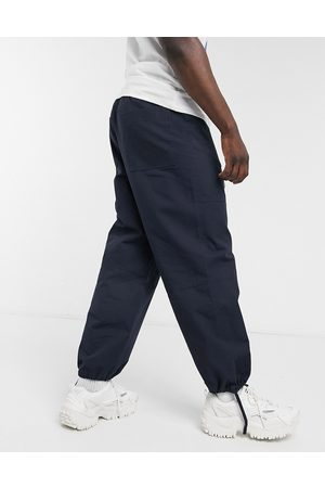 ASOS Pantalon large coupe charpentier