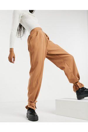 NaaNaa Femme Leggings & Treggings - Pantalon taille haute à chevilles nouées