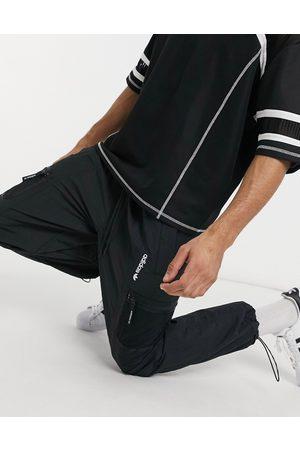 adidas Adventure - Jogger en tissu avec poche