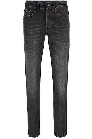 HUGO BOSS Jean Tapered Fit noir stretch aux finitions irisées