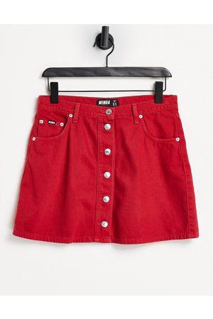 Minga London - Mini-jupe trapèze en jean avec boutons contrastants