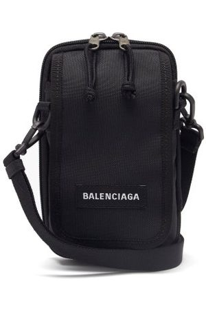 Balenciaga Sac bandoulière en toile à empiècement logo