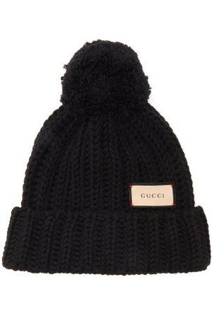 Gucci Femme Bonnets - Bonnet en laine à étiquette logo
