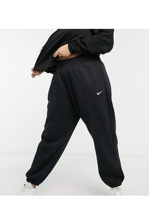 Nike Plus - Jogger oversize avec petit logo virgule