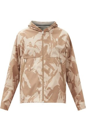 Moncler Veste imperméable à capuche et imprimé camouflage