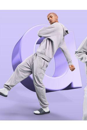 ASOS ASOS - Dark Future - Jogger décontracté à logo - Lilas délavé