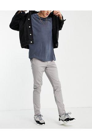 New Look Pantalon chino coupe skinny - clair