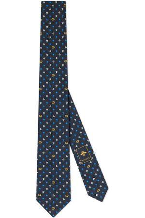 Gucci Cravate en soie avec motif GG et fleurs