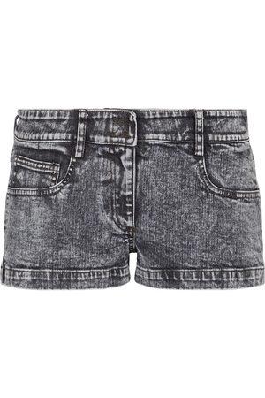 Norma Kamali Short en jean à taille basse