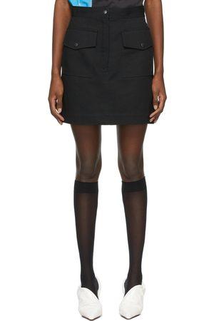 DRIES VAN NOTEN Mini-jupe noire en gabardine