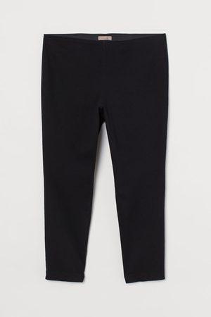 H&M + Pantalon super stretch