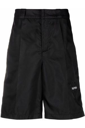 VALENTINO Homme Bermudas - Logo-print knee-length shorts