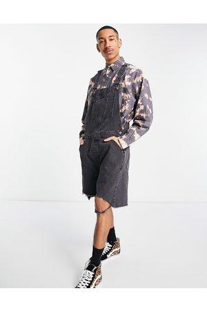 ASOS Salopette courte et large en jean à ourlet brut - délavé