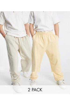 ASOS Lot de 2 joggers ultra oversize en coton biologique avec cordon de serrage à l'ourlet - Grège chiné/orange pastel