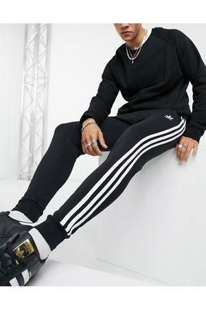 adidas Homme Joggings - Adicolor - Jogger coupe skinny à trois bandes
