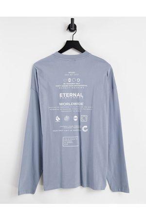 ASOS T-shirt oversize à manches longues en coton biologique avec inscription au dos