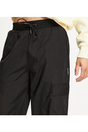 COLLUSION Pantalon cargo en nylon avec poches
