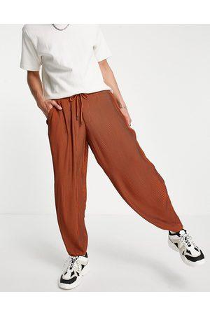 ASOS Pantalon habillé oversize fuselé et plissé avec taille élastique - Rouille