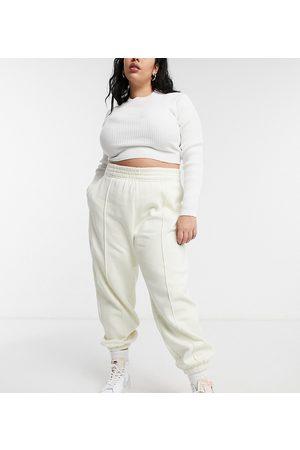 Nike Femme Joggings - Plus - Pantalon de jogging oversize avec petit logo virgule - cassé