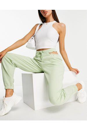 ASOS Pantalon de jogging oversize ouvert à la taille