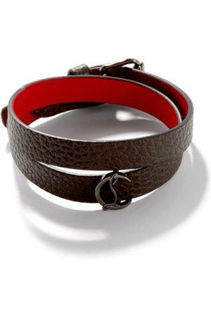 Christian Louboutin Bracelet en cuir à plaque monogramme Loubilink