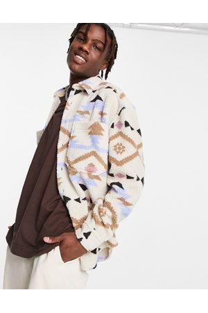 ASOS DESIGN Homme Casual - Chemise en imitation peau de mouton style années 90 à imprimé aztèque