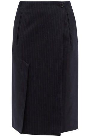 Prada Jupe de tailleur asymétrique en laine à fines rayures