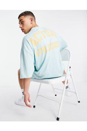 ASOS Athleisure - T-shirt oversize à imprimé graphique à l'avant et au dos - canal