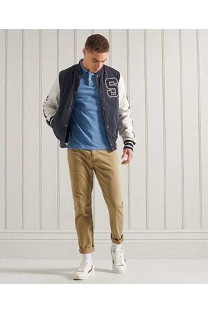 Superdry Homme Polos - Polo à manches courtes en piqué de coton biologique