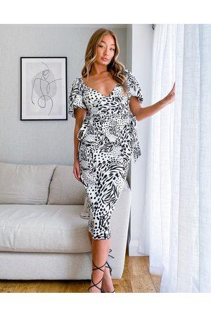 ASOS ASOSDESIGN - Robe fourreau mi-longue nouée sur le côté à manches bouffantes et imprimé abstrait - Noir et blanc