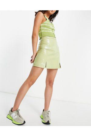 Muubaa Mini-jupe en cuir fendue sur le devant - verni