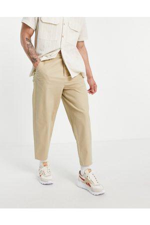 ASOS DESIGN Pantalon chino fuselé oversize - Beige-Neutre