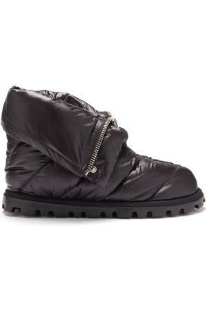 Miu Miu Bottes de ski matelassées zippées