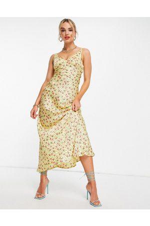 ASOS Robe nuisette longue en satin avec coupe en biais et imprimé à pois et petites fleurs - Jaune