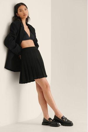 NA-KD Femme Mini-jupes - Jupe Courte Plissée Recyclée Style Tennis - Black