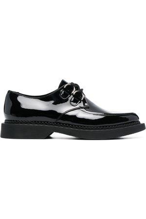 Saint Laurent Chaussures Teddy lacées à effet brillant