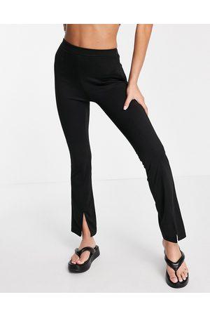 ASOS Femme Leggings & Treggings - Pantalon skinny stretch à taille haute avec ourlet fendu sur le devant