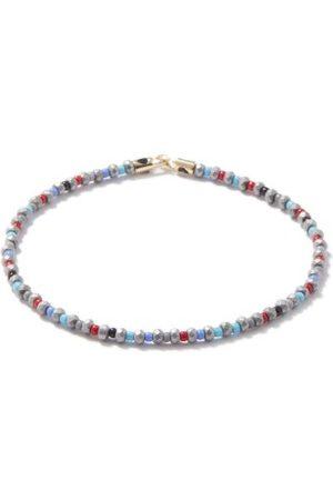 LUIS MORAIS Bracelet en hématite, perles et 14 carats