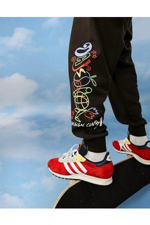 ASOS Day Social ASOS Daysocial - Jogger oversize avec logo griffonné et imprimés graphiques (pièce d'ensemble)